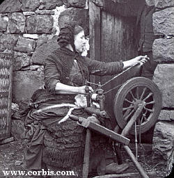 Spinster and spinning wheel, late 19th century.